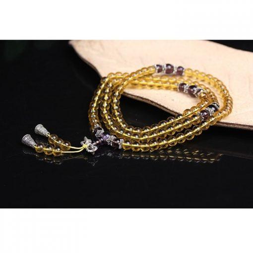 bracelet-mala-citrine-pose-sur-bois